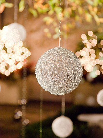 Add Magic with Metal Ornaments     Woven-metal orbs that resemble delicate balls of boucle yarn take a modern, industrial material to a new decorative level. The balls move with the air, reflect the lights of the landscaping at night, and sparkle in the sunlight by day.