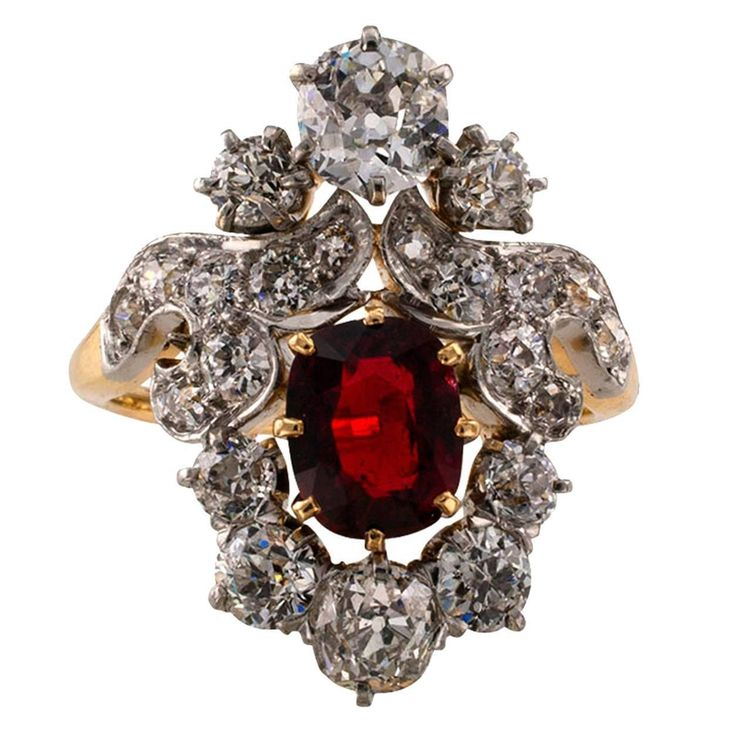 Edwardian Red Spinel Diamond Gold Platinum Ring. This ring features a fine bright and vibrant cushion cut red Spinel weighing approximately 1.50 carats, set in a lavish gold and platinum ring along with twenty-two old mine cut diamonds totaling approximately 2.50 carats