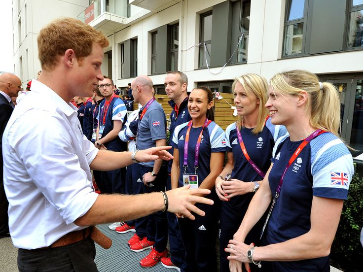 Prince Harry talks with athletes, including Great Britain's Jessica Ennis (3rd from R) during a visit to Team Great Britain's flats in Olympic Village, located in Stratford.