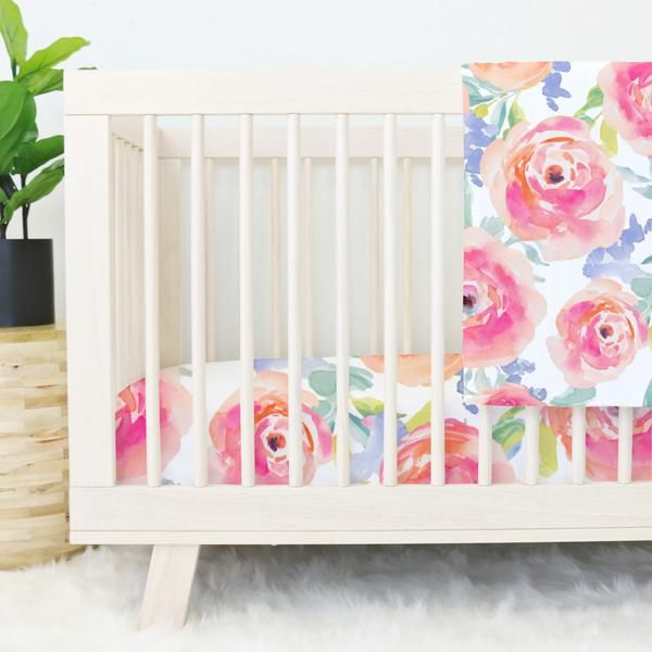 I love the bright watercolor florals in this adorable baby girl crib bedding collection!