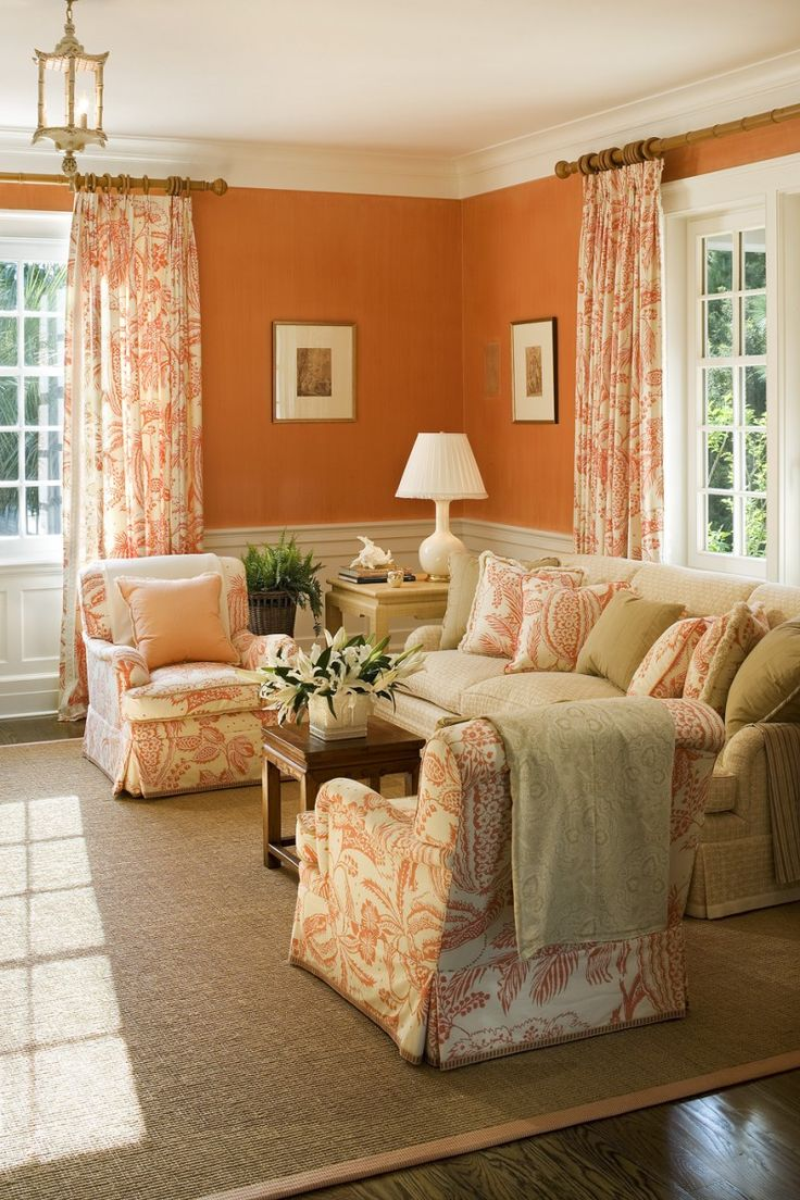 Absolutely love the hermes orange walls and the manuel canovas print club chairs pillows and draperies in this sitting room by terry sullivan on i