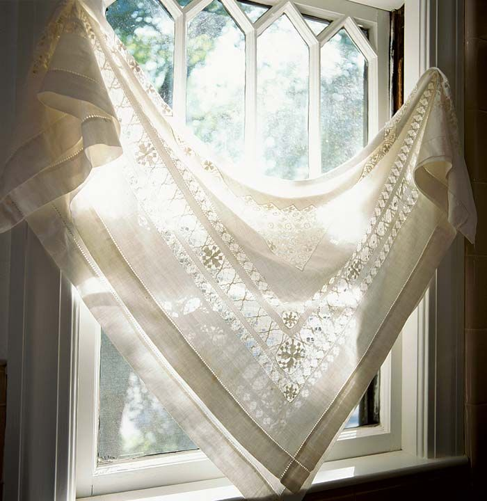 A vintage lace tablecloth, draped diagonally, is a simple but dramatic window treatment. I have several interesting tablecloths I could use in this way. What to do with the matching napkins?