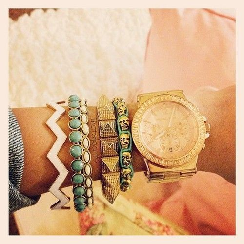 Michael Kors's gold faced watches are so pretty <3