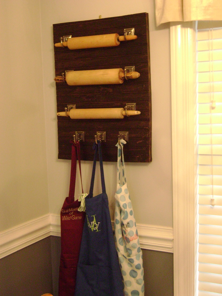 Rolling Pin *and Apron display on bead board (with added wood backing for depth) using hooks from Home Depot; displayed on kitchen wall
