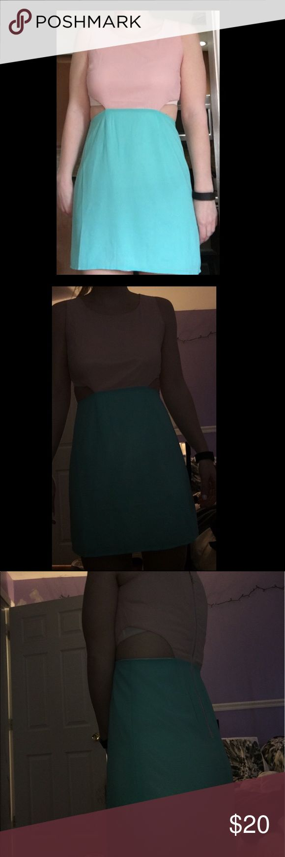 Pink& Seafoam green cut out sides Dress Cute dress perfect for upcoming weather! Bought from TOBI! NEW WITH TAGS. Cut outs on side. Pictures shown you can see the bra but that is because of the type of bra I have on! Price very negotiable! All offers accepted :) Tobi Dresses Mini
