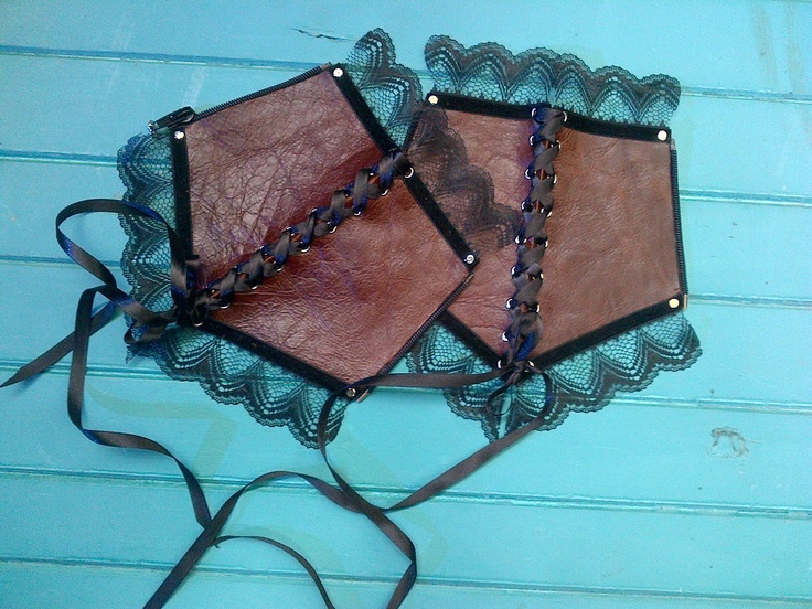 Brown leather (shiny side up)  Black lace  Black velvet ribbon  Black satin ribbon  Silver rivets  Silver eyelets