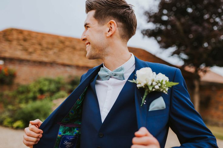 A beautiful 3 piece blue suit by Ted Baker paired with bowtie and pocket square looks fantastic. Photo by Benjamin Stuart Photography #weddingphotography #tedbaker #groom #3piece #bluesuit #weddingday #weddingsuit #buttonhole