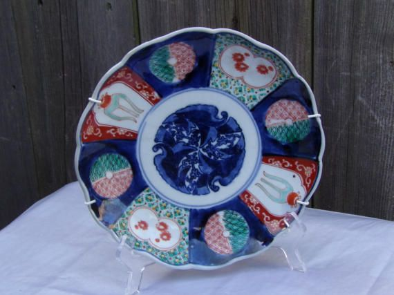 Antique Japanese Imari Porcelain Plate Meiji Period Late 19th century with fluted sides, The panels are highly detailed with cobalt, bittersweet, light blue, green, made for the internal market given the colors.  Very good overall Condition with no chips or repairs.  22cm in diameter. It is not only Good to collect this is for connoisseurs.   Your purchase will be shipped within 1-3 business days, we use Royal Mail, register mail with a tracking number. Each item will be sent to the address…