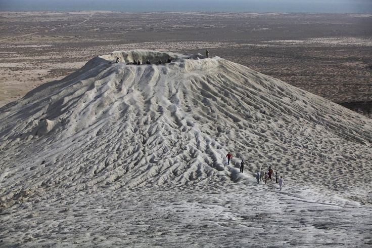 Hindu devotees climb towards the crater of a mud volcano to perform a ritual offering of coconuts during a pilgrimage to the Shri Hinglaj Mata Temple in Pakistan's Balochistan province, on April 24, 2011. Thousands from Pakistan and India take part in the annual four-day pilgrimage to the temple, which is a revered site for Hindus. (Reuters/Akhtar Soomro)