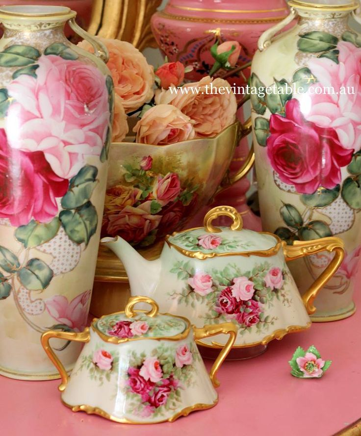 Hand painted roses on a vintage fine bone china tea set and vases, some of my favorite pieces.
