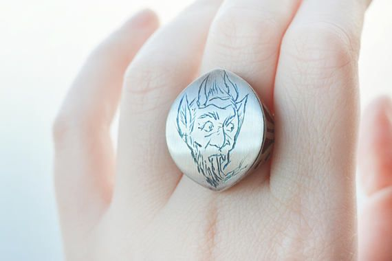 This is a vintage lucky devil sterling silver ring. Large statement almond shape ring with cutout side and hand etched (by me) little forked tongue little devil.  I have been graving in the traditional style for a while now and I really love it. I decided to etch a little devil on this