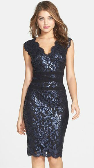 A classic navy cocktail dress... with a bit of metallic lace