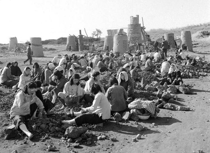 Peasants preparing raw material for the furnaces
