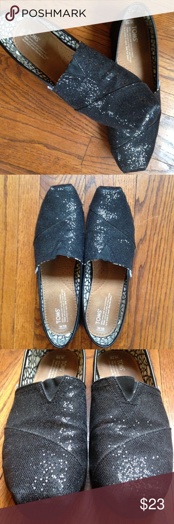Black Glitter TOMS Classic Slip-On Size 10 TOMS classic slip-on in fun black glitter! In overall great condition with few signs of wear - tiny blue scuff on toe of right foot, some wear back of right heel, and dirt marks inside heel areas of both. Lots of life left in these shoes! TOMS Shoes Flats & Loafers