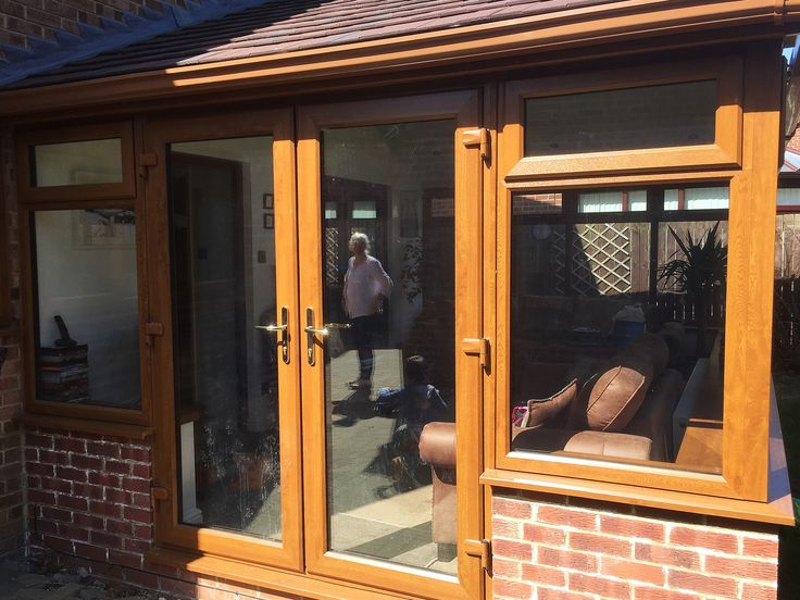 Stunning and Unique, a Large Golden Oak Conservatory, with Rehau Foiled Golden Oak Profile, with beautiful Gable Roof Feature, and Solid Energy Efficient, lightweight Supalite Metro Tiled Roof.