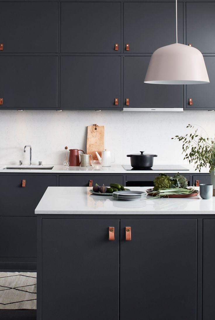 Modern navy kitchen with leather finger pulls