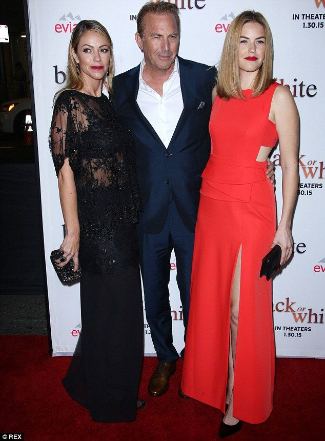 Family man: Kevin Costner was outshone by his glamorous wifeChristine Baumgartner (left) and daughter Lily Costner (right) at the LA premiere of Black or White