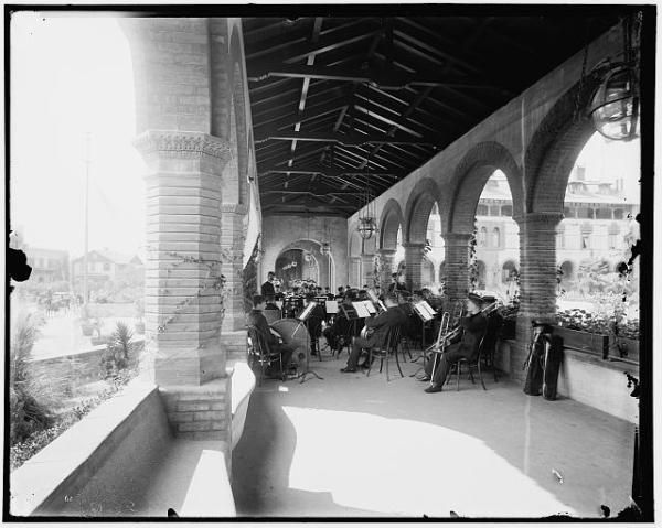 [The band in the loggia, St. Augustine] Photographer: William Henry Jackson, 1843-1942 Related Names: Detroit Publishing Co. , publisher Date Created/Published: [between 1880 and 1897]