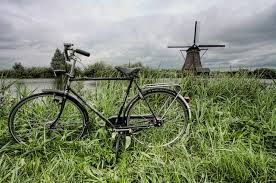 Kinderdijk, Netherlands - Riding bikes in the pouring rain and laughing the whole way!