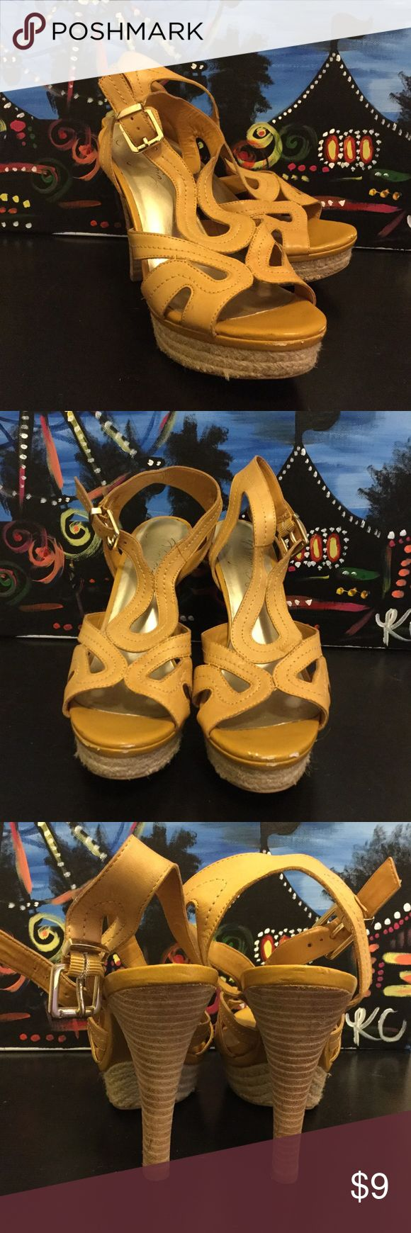 👠 Fergie Yellow Mustard Shoes 👠 Size 8.5. Pre loved shoes. 5 inches heels with 1.25 inch elevation in the front so it feels like 3.5 heels. Very comfortable. Front heels are made of jute rope as in espadrilles. Scruffiness under the bridge noted on the right shoe. Not noticeable during normal wear. PRICED TO SELL. Price firm. Fergie Shoes Heels