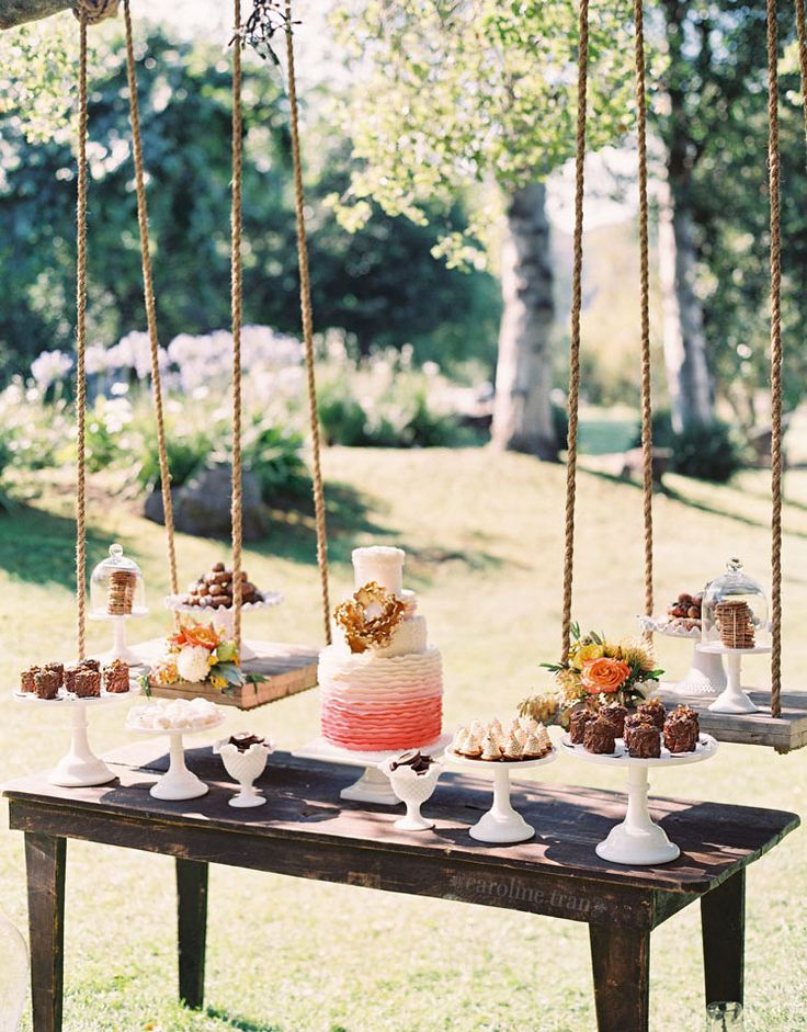amazing dessert table with suspended desserts