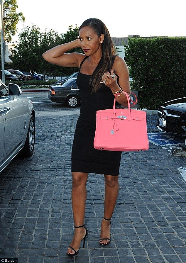 Mel B brightened up her LBD with a bright pink Hermes Birkin bag http://dailym.ai/1taCPjH