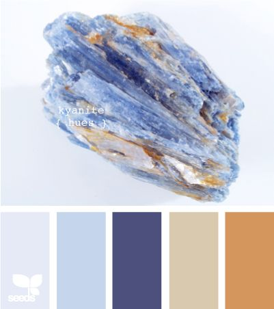 kyanite hues. the stone in the image has the same coloring as that funky tile we're using in our bathroom, though the tile has more of the deeper blue you see in the middle here.