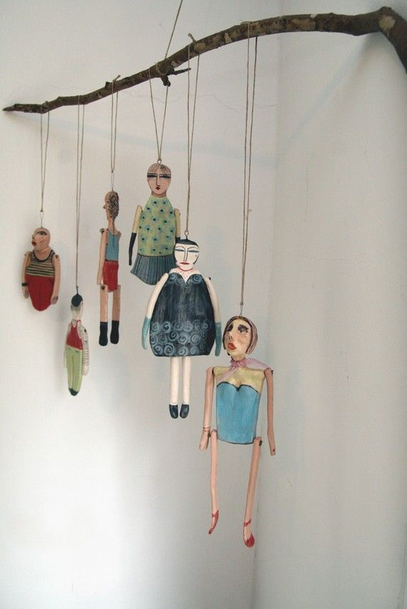 [ d e t a i l s ]    ceramic Marionette.    can be hung on the wall.  or from the ceiling.    can be part of a moblie.