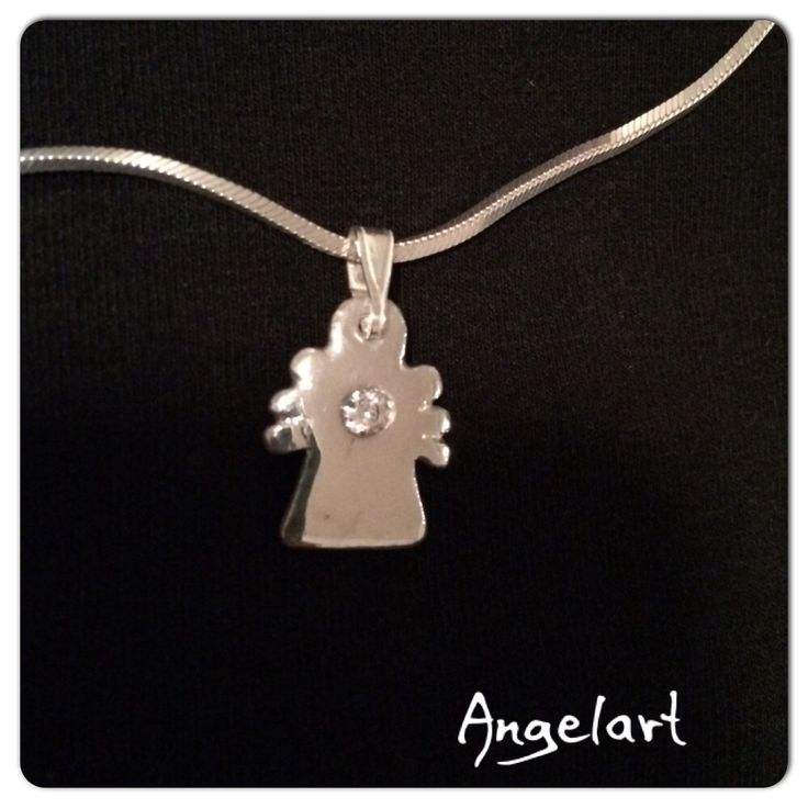 Angel charm in 999 Fine silver with a white 5 mm zircon made by Angelart