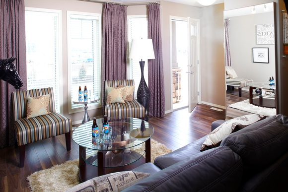 Great living space. Stunning floor-to-ceiling curtains in dramatic purple.