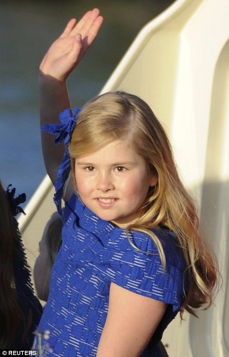 Dutch Crown Princess Catharina-Amalia waves to the crowd during a boat parade in Amsterdam April 30