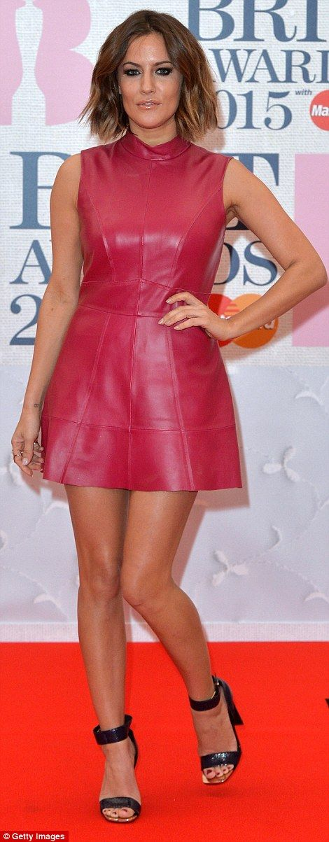 Caroline Flack's shiny pink dress was like something out of a budget space age film and the skater shape of the frock did left us unexcited