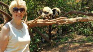 Kathy Slamp with lemurs of Madagascar.