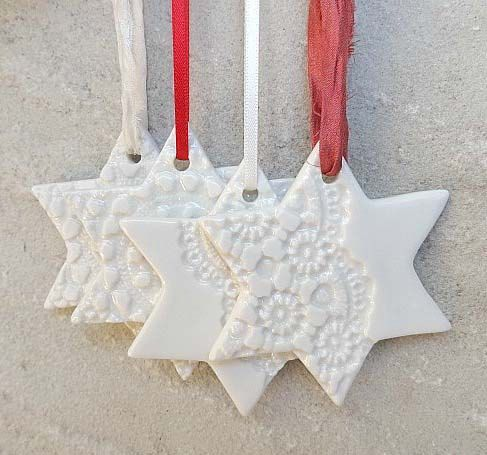 Personalised Christmas decoration. Hand engraved porcelain star with your choice of ribbon. Ceramic Christmas ornament. White star.