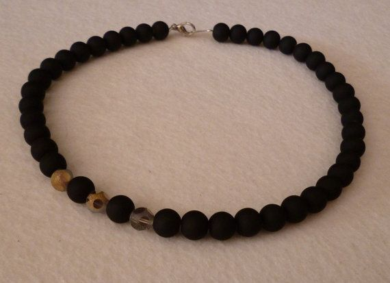 Necklace with matt black glass beads and silver-gold by GIASEMAKI