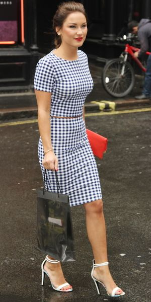 Sam Faires rocks a cute purse friendly two piece from Pull & Bear.   http://www.reveal.co.uk/fashion/news/a568280/sam-faiers-is-a-stunner-in-bargain-gingham-co-ords-and-white-heels.html