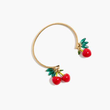"This cherry charm bracelet = our fresh accessory pick. P.S. You'll be seeing even more fruit motifs this summer... Get excited. <ul><li>Length: 42 1/2"".</li><li>Acetate links, cotton fabric.</li><li>Import.</li></ul>"