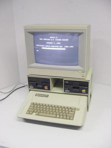 Apple IIe Computer with monitor and dual floppy disk drives - my geek friend and I developed a landscape design system on one of these circa 1982