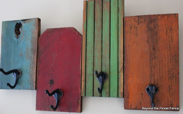 scrap wood turned into hanger.  add initial or design for that extra.