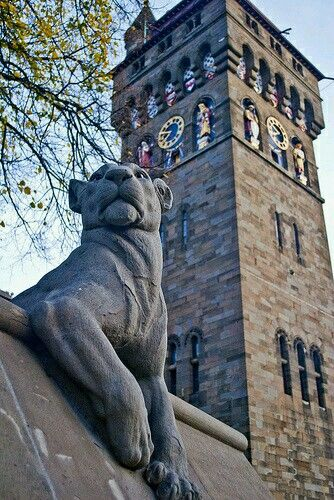 The clock tower and guarding lioness at Cardiff castle in Cardiff, South Wales, UK.