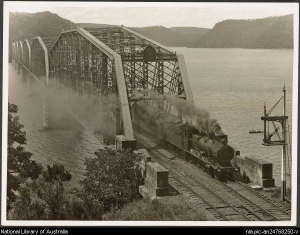 Buckland, John L 1915-1989. The Newcastle Express coming off the Hawkesbury River bridge, New South Wales, ca.1930 [picture] [ca. 1930]. 1 photograph : b ; 20.2 x 15.1 cm. Part of Buckland collection of railway transport photographs [picture]. [ca. 1930-1988] From National Library of Australia collection http://www.nla.gov.au/apps/cdview/?pi=nla.pic-an24768250 nla.pic-an24768250