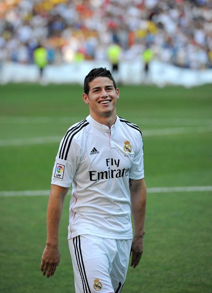 James Rodriguez smiles during his unveiling as a new Real Madrid player at the Santaigo Bernabeu stadium on July 22, 2014 in Madrid, Spain. Real agreed to buy Rodriguez from AS Monaco for the next six seasons for an undisclosed transfer fee.