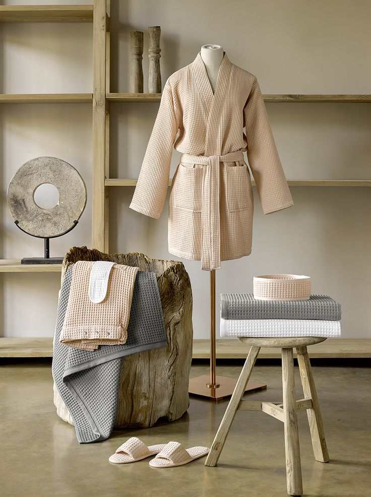 Bath linen collection 'Namaom' with waffled structure for a luxurious wellness experience. #bath #linen #collection #waffled #wellness #sauna #shower #bathrobe #towel #slippers #hair #fillet #pink #coral #grey #gray #white #rustic #wood #dewittelietaer #dwl