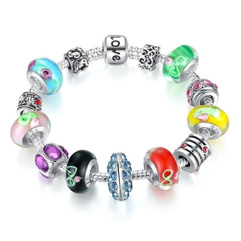 Playful charm bracelet with colorful beads brings the feeling of summer.