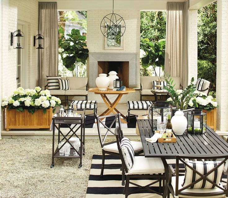 Black and white outdoor patio, a little less striped stuff would be more visually pleasing