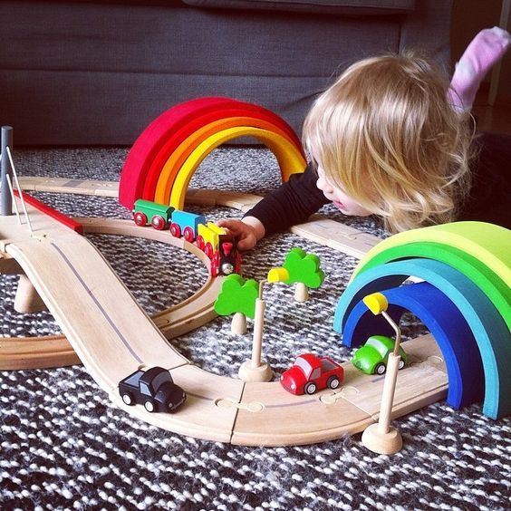 All of Grimms Toys are all handcrafted with non-toxic, natural dyes in Europe.  The rainbow is made from a single piece of wood and has a great slightly rough tactile feel and is great for the development of creativity and sensory awareness for kids and adults :)