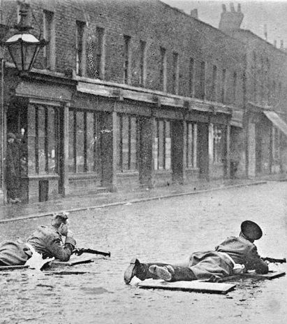Scots Guards open fire during the Siege of Sidney Street. London, 3rd January, 1911.