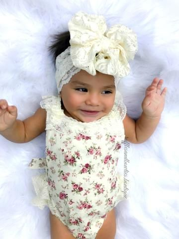 Kryssi Kouture Exclusive Girls Alexandra Ruffled Lace and Vintage Floral Romper  Sweet and adorable is this beautiful vintage inspired romper.  With a cream and soft colored florals accented with lace ruffles on the bottom.  She will look like she stepped right out of a beautiful dream.  Perfect for a vintage themed first birthday party or for an unique and adorable photo shoot.  This is a piece that you will hold onto as a keepsake.  Dress it up with a string of pearls and a beautiful…