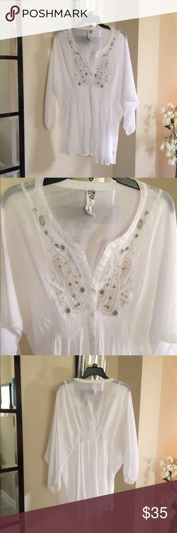 Free people embroidered white gauze top small Free people white gauze top size small. Beautiful beige embroidery on the front and smocked in the back. Flowy and sheer. In excellent condition. Smoke free home. Free People Tops Blouses