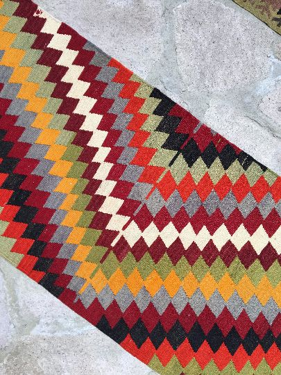 """A vintage Anatolian kilim rug Runner . It has got """"Nomade"""" design and completely hand made. It is a flat weave made wool on wool,about 45 years old and in perfect condition, totally clean; ready for use  Dimensions:2'6'' x 13'3'' ft /4.03 x0.76 mt Stock Number: 545  We accept all credit cards and PAYPAL"""